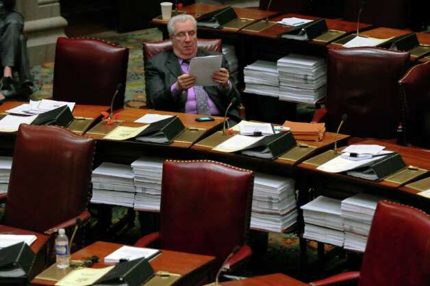 State Senator Carl L. Marcellino, a member of the Republican majority, reads on the floor of the Senate chamber at about 9 p.m. on Wednesday night March 14, 2012 in Albany, N.Y. (Philip Kamrass / Times Union ) Photo: Philip Kamrass