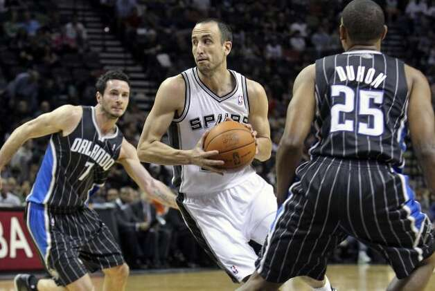 Spurs guard Manu Ginobili looks to pass in the first half as the Spurs play the Orlando Magic at the AT&T Center  on March 14, 2012  Tom Reel/ San Antonio Express-News (TOM REEL / San Antonio Express-News)