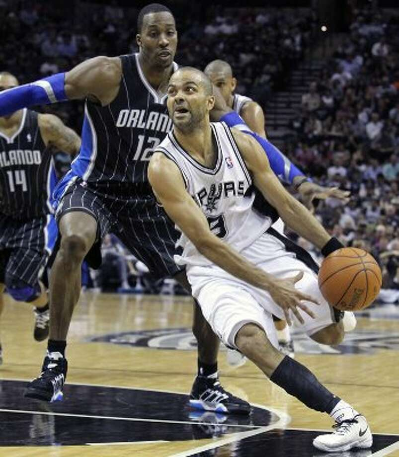 Tony Parker blows by Dwight Howard as the Spurs play the Orlando Magic at the AT&T Center  on March 14, 2012  Tom Reel/ San Antonio Express-News (TOM REEL / San Antonio Express-News)