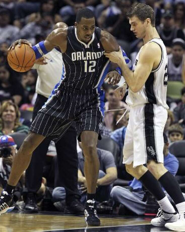 Tiago Splitter defends against Dwight Howard in the first half as the Spurs play the Orlando Magic at the AT&T Center  on March 14, 2012  Tom Reel/ San Antonio Express-News (TOM REEL / San Antonio Express-News)