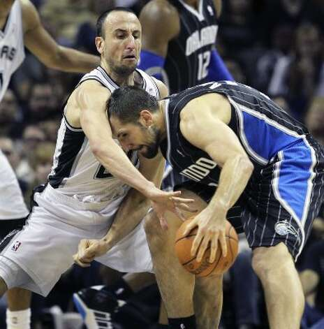 Manu Ginobili puts defensive pressure on Ryan Anderson as the Spurs play the Orlando Magic at the AT&T Center  on March 14, 2012  Tom Reel/ San Antonio Express-News (TOM REEL / San Antonio Express-News)