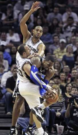 Manu Ginobili goes in to tie up Dwight Howard as he posts up on Tim Duncan in the fourth quarter as the Spurs play the Orlando Magic at the AT&T Center  on March 14, 2012  Tom Reel/ San Antonio Express-News (TOM REEL / San Antonio Express-News)