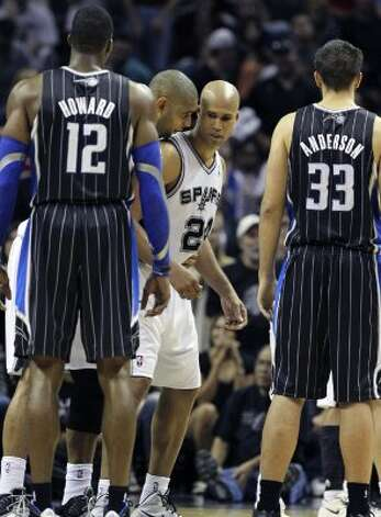 Tim Duncan whispers some strategy to Richard Jefferson as the Spurs play the Orlando Magic at the AT&T Center  on March 14, 2012  Tom Reel/ San Antonio Express-News (TOM REEL / San Antonio Express-News)