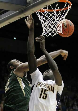 South Florida forward Toarlyn Fitzpatrick blocks a shot by California forward Bak Bak (15) in the first half of an NCAA tournament first-round college basketball game, Wednesday, March 14, 2012, in Dayton, Ohio. (AP Photo/Skip Peterson) Photo: Skip Peterson, Associated Press