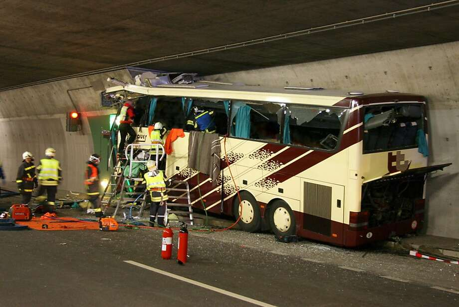 In this handout image provided by the Police of Swiss canton Valais the wreckage of a bus is seen after it crashed inside a motorway tunnel on March 13, 2012 in Sierre, Switzerland. 28 people, including 22 children, returning from a skiing holiday died in this bus accident.  (Photo by  Police Cantonale Valaisanne via Getty Images) Photo: Handout, Getty Images