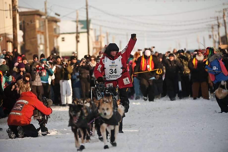 Dallas Seavey reaches the finish line to claim victory in the Iditarod Trail Sled Dog Race in Nome, Alaska, on Tuesday, March 13, 2012. (Marc Lester/Anchorage Daily News/MCT) Photo: Marc Lester, McClatchy-Tribune News Service