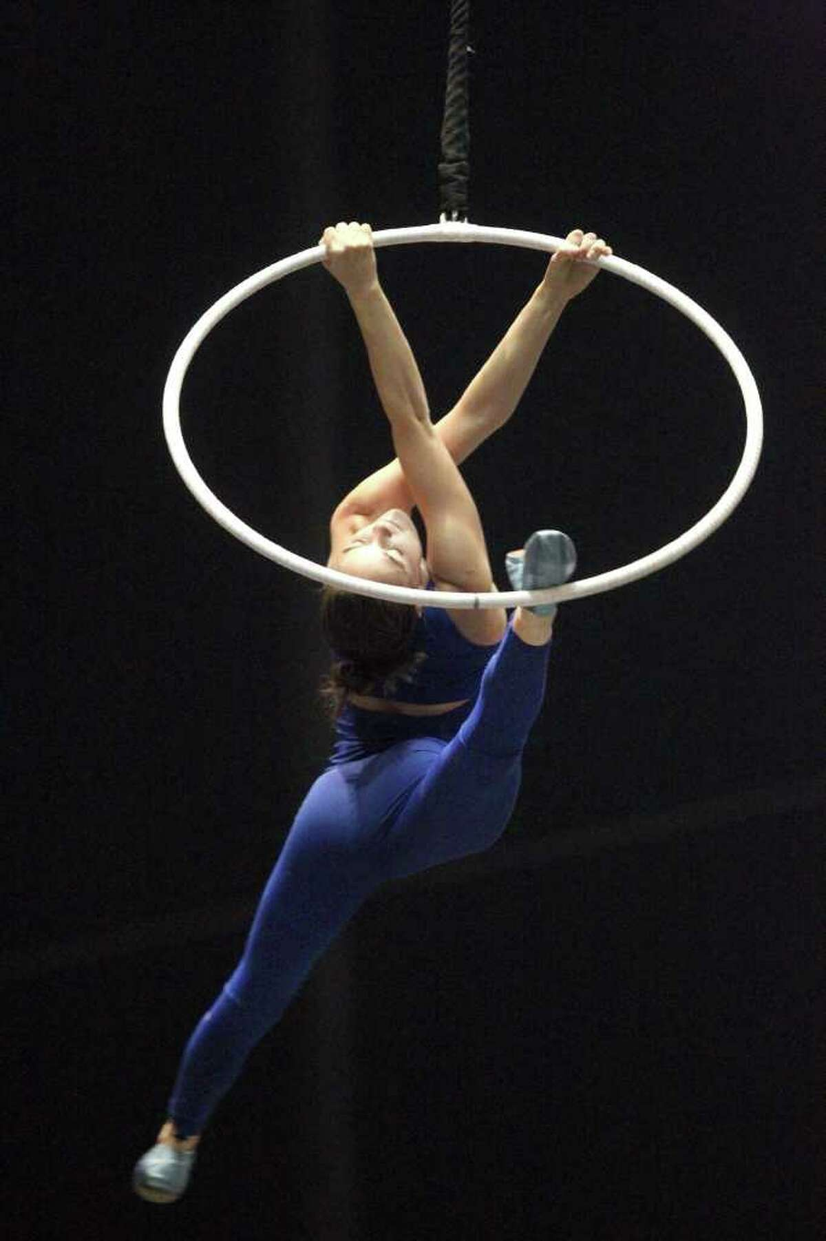 Performer Julie Cameron practices the aerial hoops for Cirque du Soleil's production of