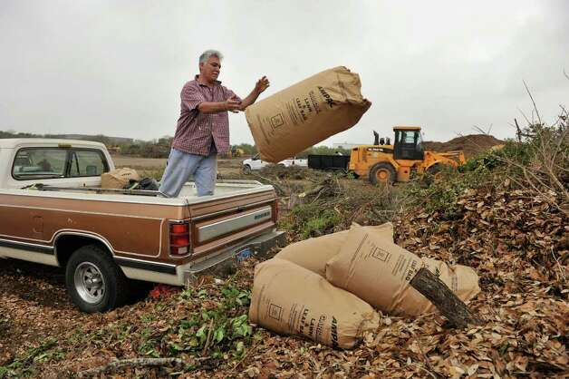 Marco Enamorado unloads yard waste at the Bitters Brush Recycling Center on Wednesday, March 14, 2012. A new facility will be opening soon on Nelson Road. Photo: Robin Jerstad, For The Express-News
