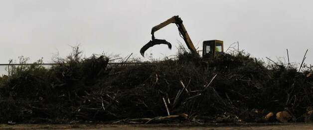 Heavy machinery moves and recycles yard waste at the Bitters Brush Recycling Center on Wednesday, March 14, 2012. A new facility will be opening soon on Nelson Road. Photo: Robin Jerstad, For The Express-News