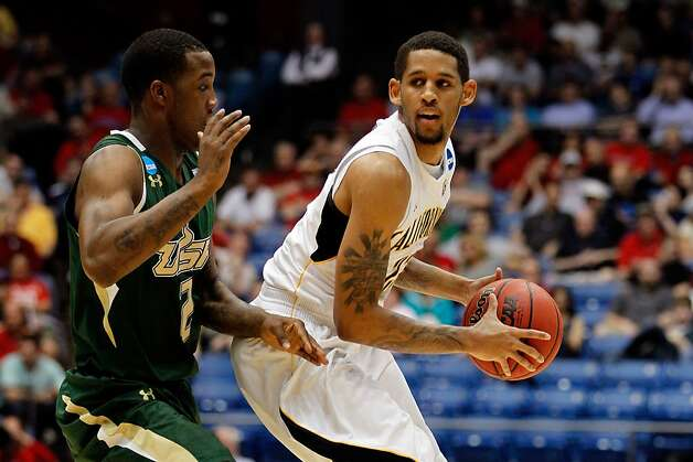 Allen Crabbe #23 of the California Golden Bears looks to pass against Victor Rudd Jr. #2 of the South Florida Bulls in the first round of the 2011 NCAA men's basketball tournament at UD Arena on March 14, 2012 in Dayton, Ohio. Photo: Gregory Shamus, Getty Images