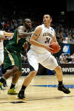 Robert Thurman #34 of the California Golden Bears moves the ball in the post in the first half against the Toarlyn Fitzpatrick #32 of the South Florida Bulls in the first round of the 2011 NCAA men's basketball tournament at UD Arena on March 14, 2012 in Dayton, Ohio. Photo: Gregory Shamus, Getty Images