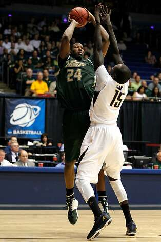 Augustus Gilchrist #24 of the South Florida Bulls attempts a shot in the second half against Bak Bak #15 of the California Golden Bears in the first round of the 2011 NCAA men's basketball tournament at UD Arena on March 14, 2012 in Dayton, Ohio. Photo: Gregory Shamus, Getty Images