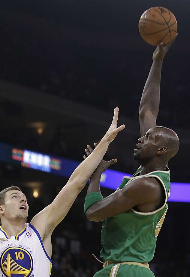 Boston Celtics' Kevin Garnett, right, shoots over Golden State Warriors' David Lee during the first half of an NBA basketball game Wednesday, March 14, 2012, in Oakland, Calif. (AP Photo/Ben Margot) Photo: Ben Margot, Associated Press