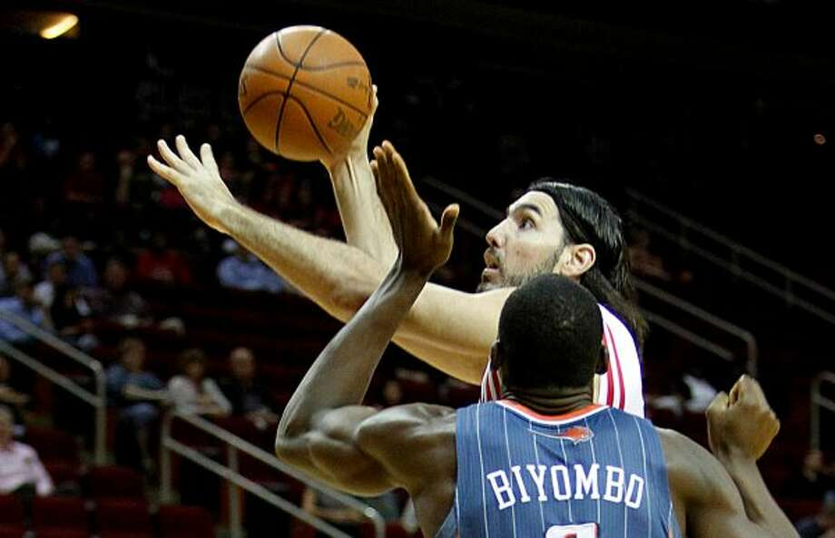 March 14: Rockets 107, Bobcats 87 Rockets forward Luis Scola (4) scores over Bobcats center Bismack Biyombo (0) in the first half. Scola finished with a game-high 23 points on 8-of-15 shooting as the Rockets won their second straight game. Record: 24-20. (Mayra Beltran / Houston Chronicle)