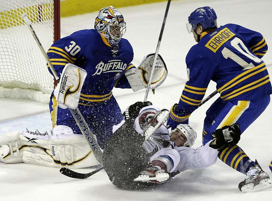 Colorado Avalanche's Ryan O'Reilly, center, collides with Buffalo Sabres goalie Ryan Miller, left, as Sabres' Christian Ehrhoff (10), of Germany, defends during the third period of an NHL hockey game in Buffalo, N.Y., Wednesday, March 14, 2012. The Avalanche won 5-4 in a shootout. Photo: David Duprey, Associated Press