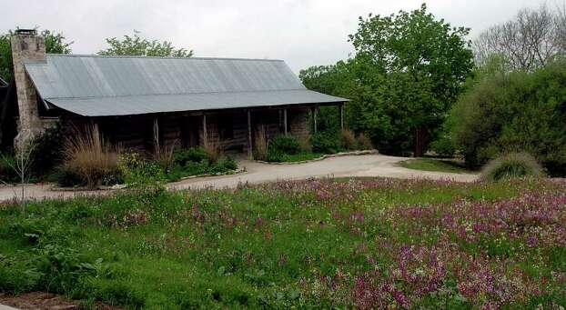 The Auldt House greets visitors as the glance across the array of colorful wildflowers at the Texas Native Trail at the San Antonio Botanical Gardens on April 5, 2006. Photo: DELCIA LOPEZ, Express-News File Photo / SAN ANTONIO EXPRESS-NEWS