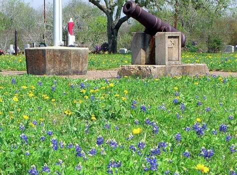 Bluebonnets signal spring on March 21, 2007, as they decorate the monument to the men slain at Goliad on March 27, 1836. Photo: FORREST M MIMS III, Express-News File Photo / SAN ANTONIO EXPRESS-NEWS
