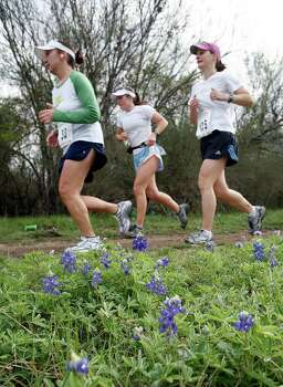 Trail runners pass a patch of bluebonnets while competing in the Prickly Pear Trail Runs at McAllister Park on March 17, 2007. Photo: J. MICHAEL SHORT, Express-News File Photo / THE SAN ANTONIO EXPRESS-NEWS