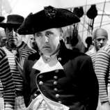 """Charles Laughton (right) as Capt. Bligh in """"Mutiny on the Bounty.""""  Laughton is just as evil and interesting in about ten other movies, one of the great, very human villains. (MGM 1935 / ONLINE_YES)"""