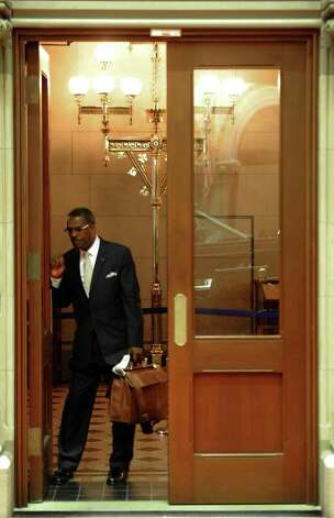 Sergeant-at-Arms Wayne Jackson closes the door of the Assembly chamber eartly Thursday morning at the state Capitol after an all-night session.  (Skip Dickstein / Times Union) Photo: SKIP DICKSTEIN