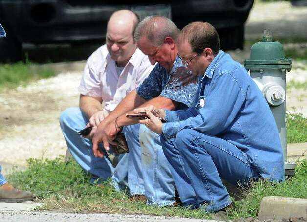 Three employees of RCI who were taken hostage by Bartholomew Granger wait to give statements to Beaumont Police.  Photo taken Wednesday, March 13, 2012  Guiseppe Barranco/The Enterprise Photo: Guiseppe Barranco, STAFF PHOTOGRAPHER / The Beaumont Enterprise