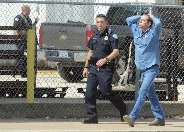 A hostage walks out of RCI after being released by gunman Bartholomew Granger during a police stand off in Beaumont on Wednesday. The event stemmed from a shooting at the Jefferson County Courthouse that left several injured and one person dead. Photo taken Wednesday, March 13, 2012  Guiseppe Barranco/The Enterprise Photo: Guiseppe Barranco, STAFF PHOTOGRAPHER / The Beaumont Enterprise