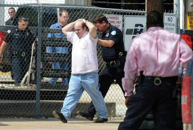 Hostages walk out of RCI after being released by gunman Bartholomew Granger during a police stand off in Beaumont on Wednesday. The event stemmed from a shooting at the Jefferson County Courthouse that left several injured and one person dead. Photo taken Wednesday, March 13, 2012  Guiseppe Barranco/The Enterprise Photo: Guiseppe Barranco, STAFF PHOTOGRAPHER / The Beaumont Enterprise