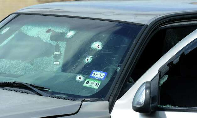 Bullet holes in Bartholomew Granger's truck. Photo taken Wednesday, March 13, 2012  Guiseppe Barranco/The Enterprise Photo: Guiseppe Barranco, STAFF PHOTOGRAPHER / The Beaumont Enterprise