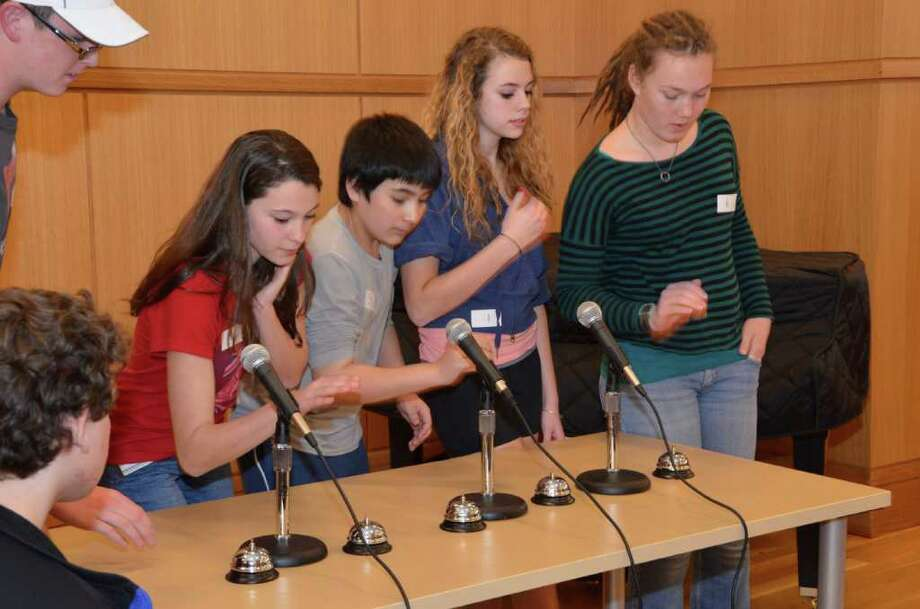 """From left, Jack Garfield, Isabella Ferrante, John Selkowitz, Emily Van Ingen and Sarah Siebert comptete in the """"Hunger Games"""" trivia contest at the Darien Library March 13, 2012. Photo by Jeanna Petersen Shepard. Photo: Contributed Photo"""