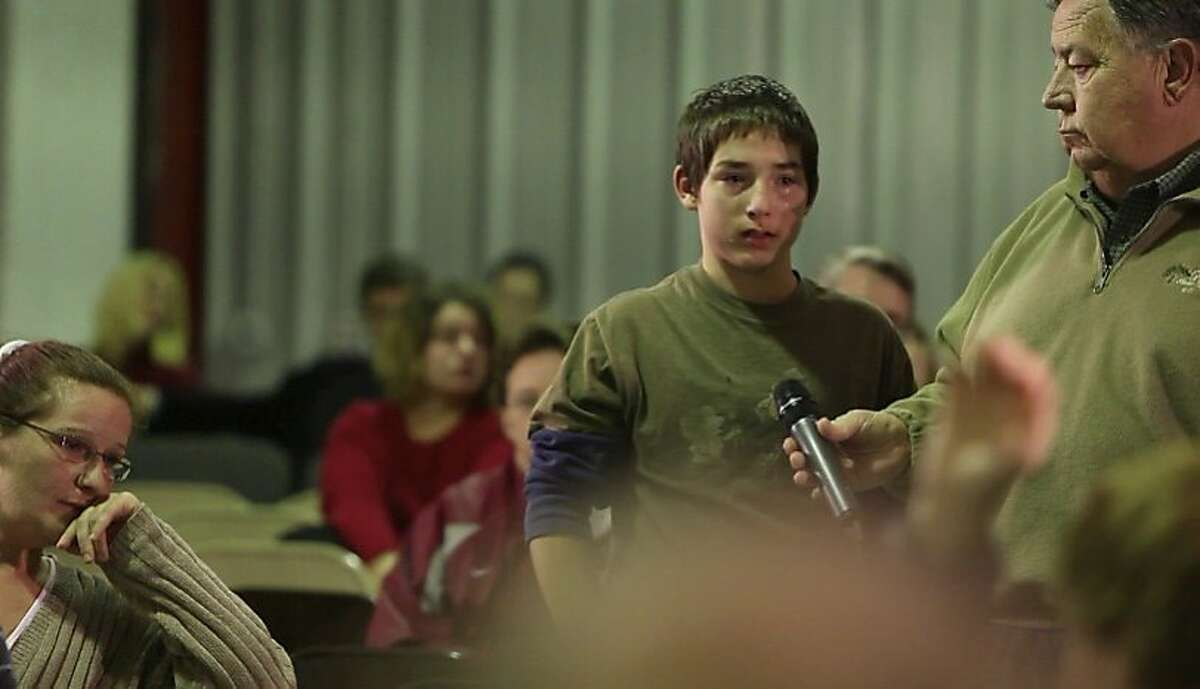 A boy speaks during a town hall meeting in,