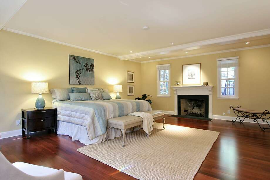 Upstairs, the spacious master suite features the home's third fireplace. Photo: Liz Rusby, The Grubb Co.