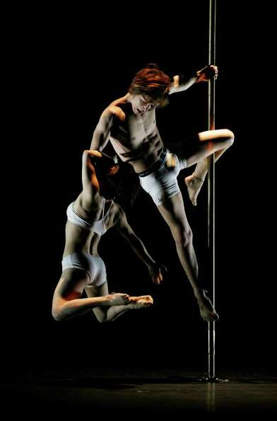 Japanese pole dancers Masayo Okamoto, left and Kazuya Naka compete for the Doubles Division at the I