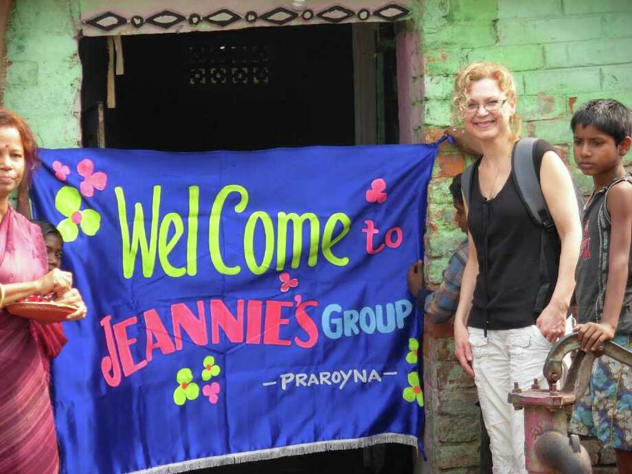 WestConn professor Jean Hatcherson is welcomed at a vocational school in Kolkata, India. The school is in a Muslim slum area where children are taught literacy and basic math skills so they may reach age-appropriate grade levels.  Enrichment programs include drama, art, expressive language and crafts. Photo: Contributed Photo