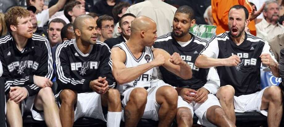 Spurs' Matt Bonner (from left), Tony Parker, Richard Jefferson, Tim Duncan, and Manu Ginobili joke on the bench near the end of the game against the Heat Friday March 4, 2011 at the AT&T Center. The Spurs won 125-95.  (PHOTO BY EDWARD A. ORNELAS/eaornelas@express-news.net) (SAN ANTONIO EXPRESS-NEWS)