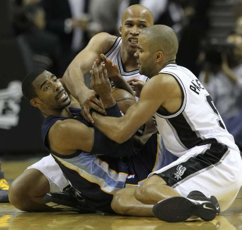Memphis Grizzlies guard Mike Conley (11) tries to call a timeout while tangled up with San Antonio Spurs forward Richard Jefferson (24) and San Antonio Spurs guard Tony Parker (9) in Game 5 of the first round of the Western Conference playoff at the AT&T Center on Wednesday, April 27, 2011. Kin Man Hui/kmhui@express-news.net (SAN ANTONIO EXPRESS-NEWS)