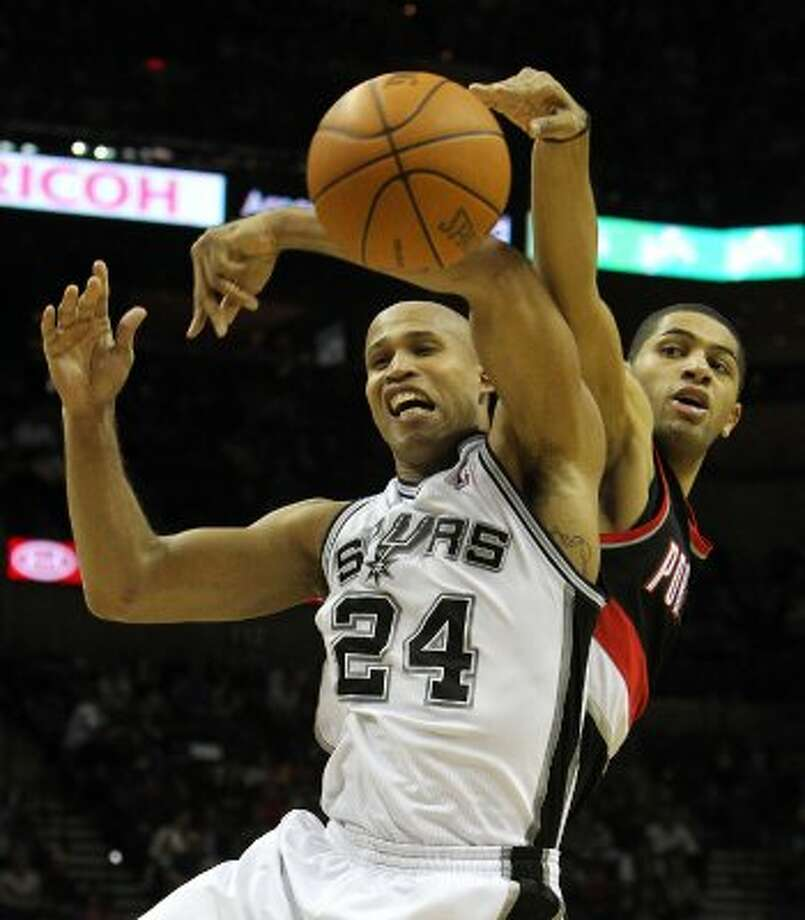Spurs' Richard Jefferson (24) struggles for a rebound against Portland Trailblazers' Nicolas Batum (88) in the first half at the AT&T Center on Friday, Jan. 13, 2012. Kin Man Hui/kmhui@express-news.net (KIN MAN HUI / SAN ANTONIO EXPRESS-NEWS)