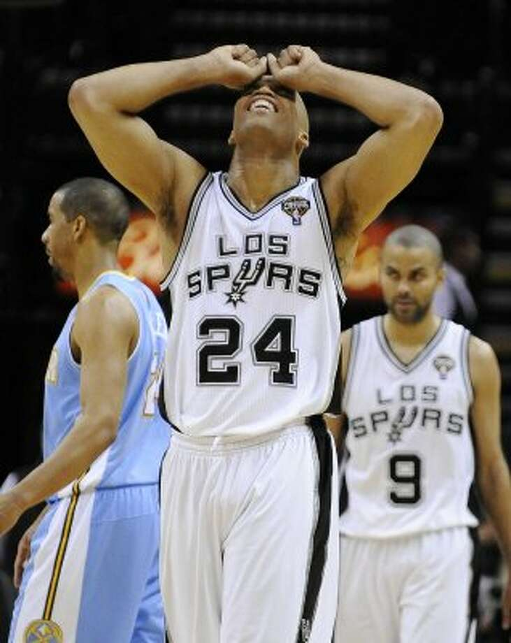 San Antonio Spurs' Richard Jefferson reacts to a missed basket in the last seconds of an NBA basketball game against the Denver Nuggets, Sunday, March 4, 2012, in San Antonio. Denver won 99-94. (AP Photo/Darren Abate) (AP)