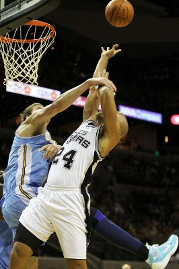 Richard Jefferson is fouled by Denver's Timofey Mozgov in the first half Spurs vs Nuggets, Sunday, March 4, 2012. (JENNIFER WHITNEY) (JENNIFER WHITNEY / SPECIAL TO THE EXPRESS-NEWS)