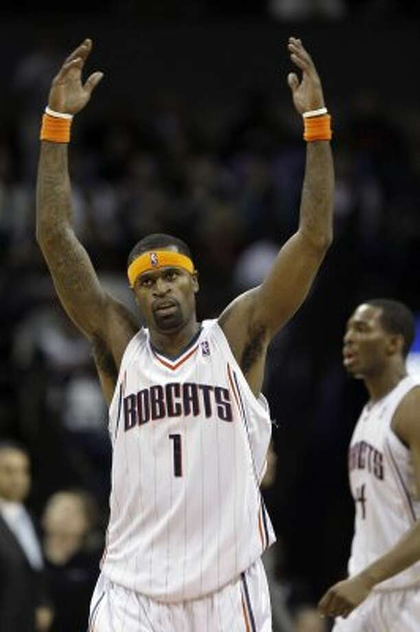 Charlotte Bobcats' Stephen Jackson reacts after making a 3-point shot against the Phoenix Suns in the first half of an NBA basketball game in Charlotte, N.C., Saturday, Jan. 16, 2010. (AP Photo/Chuck Burton) (AP)
