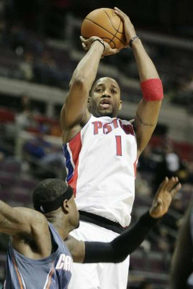 Detroit Pistons' Tracy McGrady (1) takes a shot over Charlotte Bobcats' Stephen Jackson in the second half of an NBA basketball game Wednesday, Feb. 2, 2011, in Auburn Hills, Mich. The Bobcats defeated the Pistons 97-87. (AP Photo/Duane Burleson) (AP)
