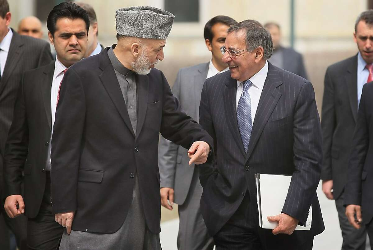 U.S. Secretary of Defense Leon Panetta (2nd R) talks with Afghanistan President Hamid Karzai (2nd L) during a visit to the Presidential Pallace on March 15, 2012 in Kabul, Afghanistan. Panetta visited with troops and met with President Hamid Karzai and other Afghan officials during his two-day visit to the country. Afghan President Hamid Karzai reportedly wants Afghan forces to take over a year earlier in 2013 and wants U.S. troops to pull out of villages after a U.S. soldier allegedly killed 16 Afghan civilians.