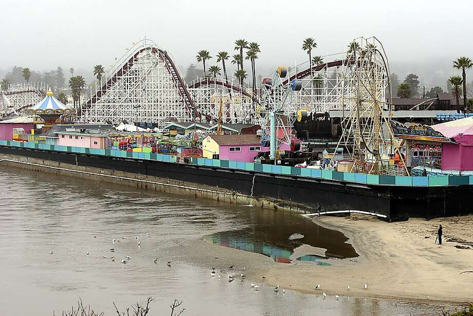 The rain-swollen San Lorenzo River threatens to undermine the historic Santa Cruz Beach Boardwalk in Santa Cruz, Calif., Thursday, March 15, 2012.  A late winter storm that brought heavy rain and winds to Central and Northern California has led to at least one fatality and threatened flooding at the popular Santa Cruz Beach Boardwalk. Photo: Dan Coyro, Associated Press