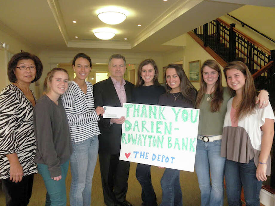 Pictured from left with Darien/Rowayton Bank President Bob Kettermann and Asstistant Treasurer Kaye Leong are Cammie Lattimer, Secretary Cammie Kirby, Co-President Jenny Bealle, Co-President Phoebe Cush and Vice-Presidents Parker Hamill and Morgan Malvisi. Photo: Contributed Photo