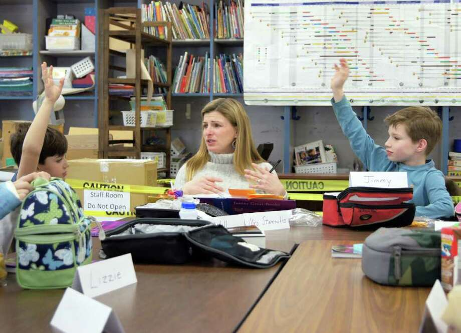 """Will Stamoulis, left, co-leader Karen Stamoulis, and Jimmy Mac Nedder discuss a Nigerian folktale titled """"It's All the Fault of Adam."""" Photo: Contributed Photo"""