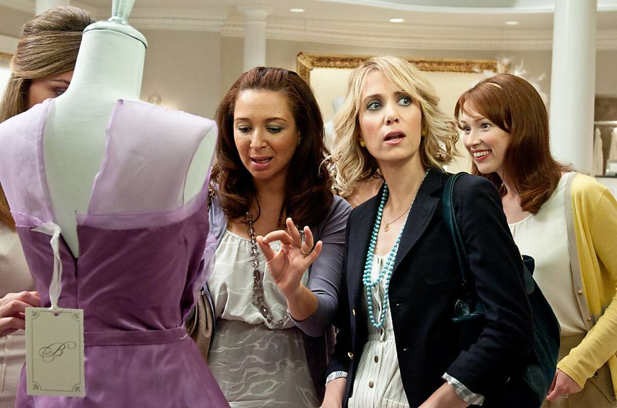 """(L to R) ROSE BYRNE, MAYA RUDOLPH, KRISTEN WIIG and ELLIE KEMPER in """"Bridesmaids"""". In the comedy, Wiig stars as Annie, a maid of honor whose life unravels as she leads her best friend, Lillian (Rudolph), and a group of colorful bridesmaids on a wild ride down the road to matrimony."""