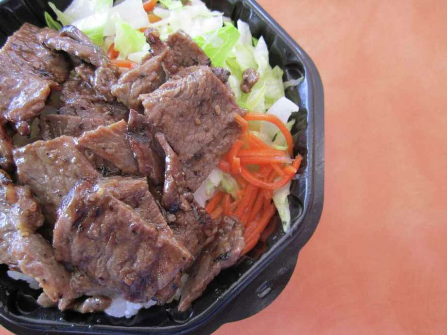 Thinly sliced Korean kogi steak, lettuce and carrots are layered atop a bed of steamed white rice in the Kogi Bowl at Tiger Pop. Photo: Jessica Elizarraras, San Antonio Express-News