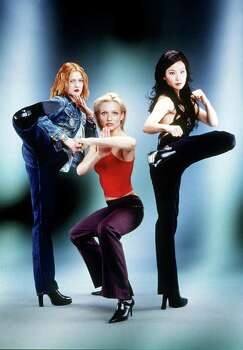 Actors Drew Barrymoore, left, Cameron Diaz and Lucy Liu are shown in this publicity photo for the new film 'Charlie's Angels,' provided by Columbia Pictures. The three actors are following in the high-heeled footsteps of their predecessors, wearing sexy, stylish and trendsetting clothing in the film which is based on the 1970s TV show of the same name. (AP Photo/Columbia Pictures/Darren Michaels,HO) Photo: DARREN MICHAELS / COLUMBIA PICTURES