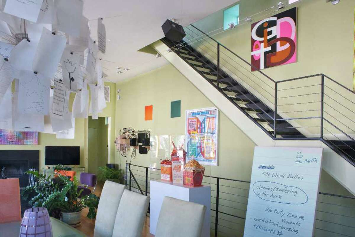 The home of Reid Sutton and Brad Nagar is filled with video art, paintings and sculptures. Leaning against the railing is