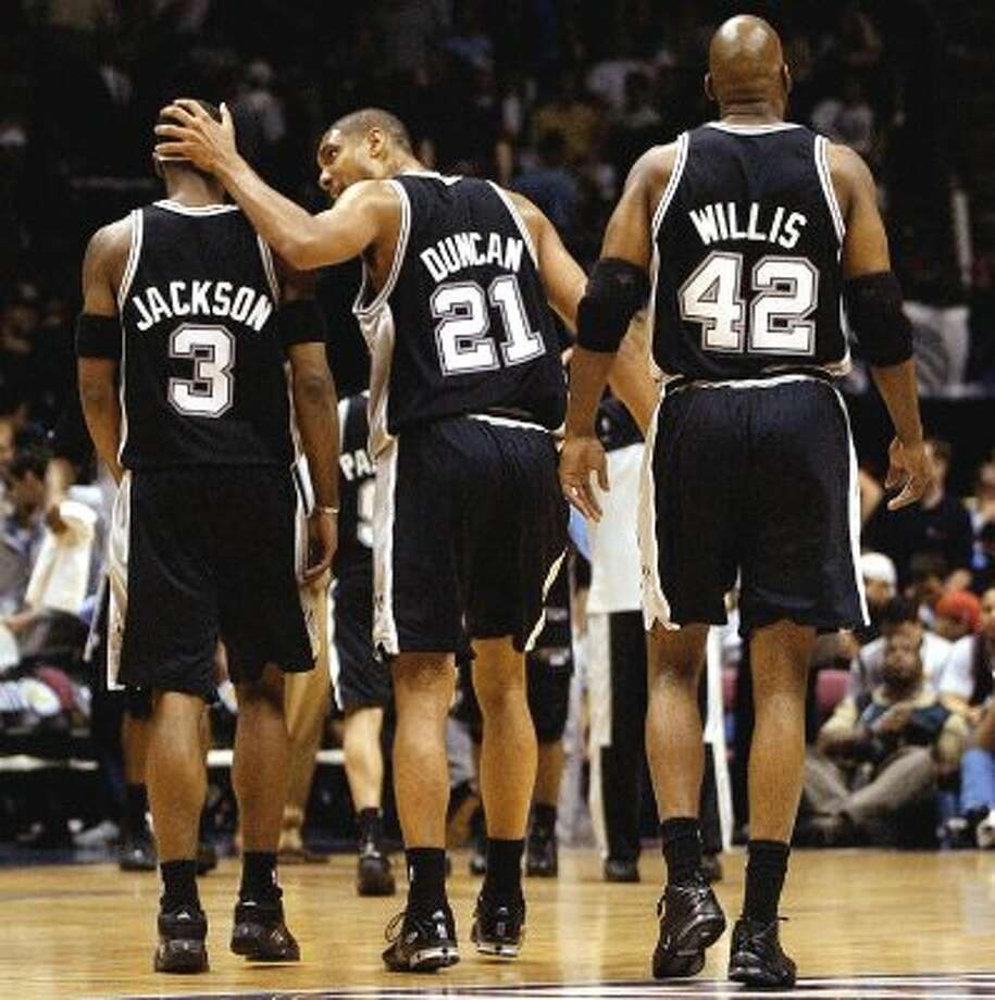Spurs Stephen Jackson, Tim Duncan and Kevin Willis during second quarter action in game five of the NBA Finals at Continental Airlines Arena in New Jersey on Friday, June 13, 2003  ( JERRY LARA STAFF ) (SAN ANTONIO EXPRESS-NEWS)
