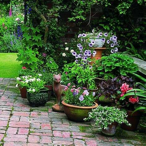"<b>Plant a container garden:</b> Don't have access to a patch of dirt? Plant in containers instead. Flowers add beautiful pops of color, shrubs or small trees add structure to a group of containers, and vines form cool, leafy screens. <b>Read more:</b> <a href=""http://www.sunset.com/travel/outdoor-adventure/spring-getaways-00418000070786/?xid=sfg-sunset-030112"">23 places to welcome spring</a> <br style=""clear:both;"" /><a href=""http://www.sunset.com"" target=""_blank"" class=""sunsetlogo""><img src=""http://imgs.sfgate.com/graphics/partners/sunset/sunset_logo.gif"" alt=""Sunset"" border=""0""/></a> Photo: Charles Mann, Sunset.com"